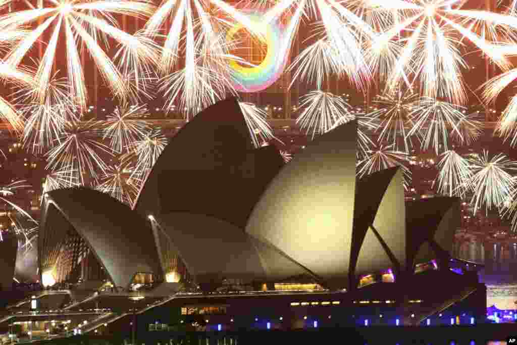 Fireworks explode over the Sydney Opera House during a pyrotechnic show to celebrate the New Year in Australia, January 1, 2012. (Reuters)