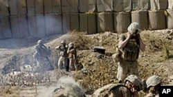 Marines of the 2nd Expeditionary Brigade fire mortar rounds from their forward operating base in Mian Poshteh in Helmand Province, 23 Nov 2009