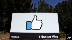 FILE - The Facebook logo is seen at the company's headquarters in Menlo Park, Calif., March 28, 2018.