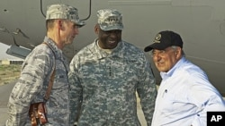 US Defense Secretary Leon Panetta, right, chats with US Generals Anthony Rock, left, and Lloyd Austin during a stop in southern Afghanistan, July 10, 2011