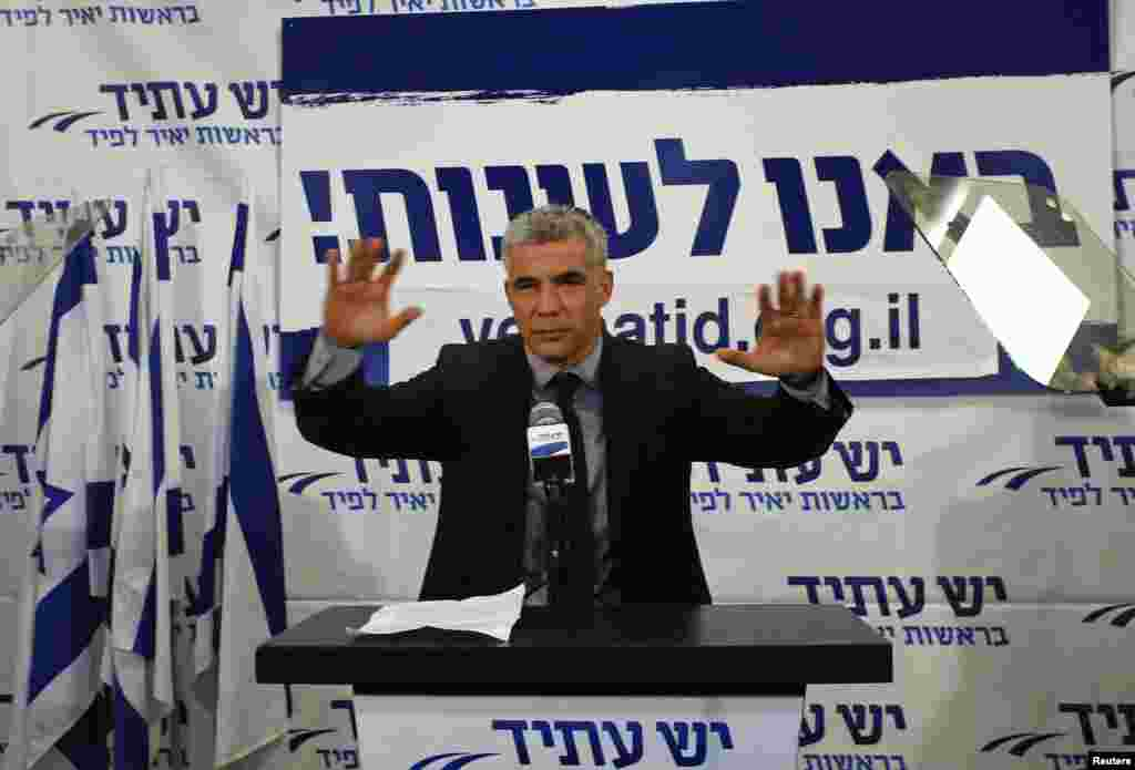 Yair Lapid, leader of the Yesh Atid (There is a Future) party, gestures in front of supporters at his party's headquarters in Tel Aviv, Israel, January 23, 2013.