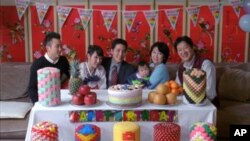 In a scene from filmmaker Andrew Ahn's short film Dol (First Birthday), a Korean-American family gathers amid traditional dol decorations.