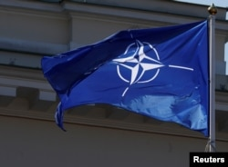 The NATO flag flies during the celebration of the 15th anniversary of Lithuania's membership in NATO in Vilnius, Lithuania, March 30, 2019.
