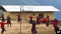 Young monks practicing a dance at the Neyphug Monastery