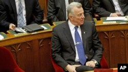 Hungarian President Pal Schmitt, who announced on Monday that he will resign from his post, waits before delivering a speech at the parliament in Budapest, Hungary, April 2, 2012.