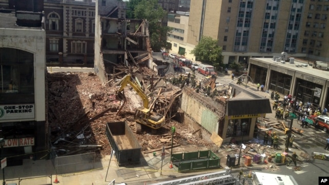 Emergency personnel respond to a building collapse in downtown Philadelphia, June 5, 2013.