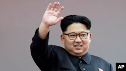 FILE - North Korean leader Kim Jong Un waves at parade participants at the Kim Il Sung Square in Pyongyang, North Korea.