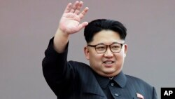 FILE - North Korean leader Kim Jong Un waves at parade participants at the Kim Il Sung Square in Pyongyang, North Korea.