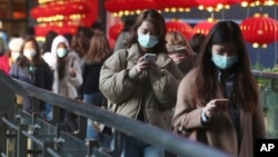 People wear face masks and walk at a shopping mall in Taipei, Taiwan, Jan. 31, 2020.