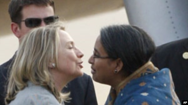 U.S. Secretary of State Hillary Rodham Clinton, left, is greeted by Bangladeshi Foreign Minister Dipu Moni upon her arrival in Dhaka, Bangladesh, May 5, 2012.