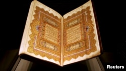Pages from a copy of the Quran dating back to 1284 are displayed at an exhibition in Doha, Qatar, Dec. 2, 2008.