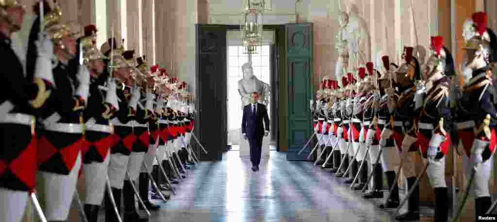 French President Emmanuel Macron walks through the Galerie des Bustes (Busts Gallery) to access the Versailles Palace's hemicycle to address both the upper and lower houses of the French parliament (National Assembly and Senate) at a special session in Versailles near Paris.