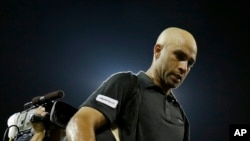 FILE - James Blake leaves the court after being defeated by Ivo Karlovic, of Croatia, in a first round match at the U.S. Open tennis tournament Thursday, Aug. 29, 2013.