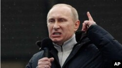 Russian Prime Minister Vladimir Putin speaks during a massive rally in his support at Luzhniki stadium in Moscow, February. 23, 2012.