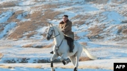 "(FILES) This undated file picture released by the Korean Central News Agency on October 16, 2019 shows North Korean leader Kim Jong Un riding a white horse amongst the first snow at Mouth Paektu. - North Korean leader Kim Jong Un is ""alive and well""…"