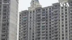 恒大一些公寓楼停建引发投资者担心