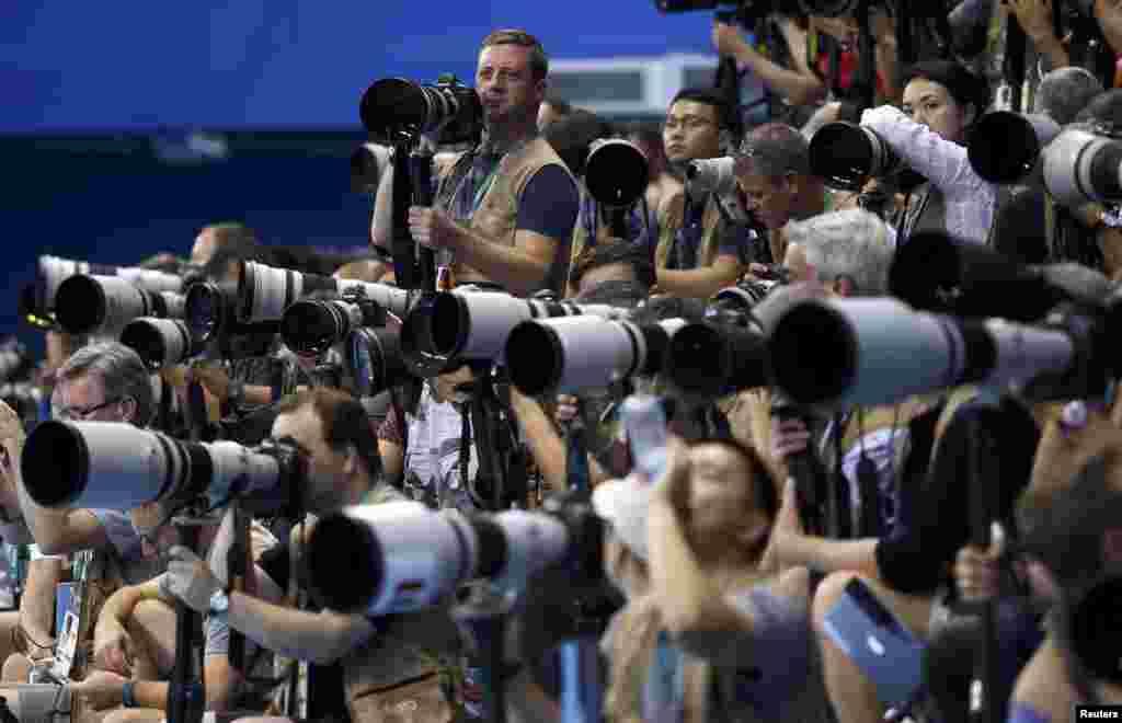 Photographers take photos of men's 100m freestyle semi-finals at Olympic Aquatics Stadium during the Rio Olympics in Rio de Janeiro, Brazil.