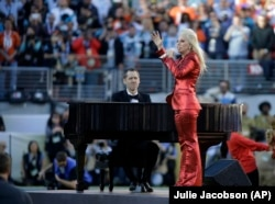 Lady Gaga sings the national anthem before the NFL Super Bowl 50 football game between the Denver Broncos and the Carolina Panthers, Sunday, Feb. 7, 2016, in Santa Clara, Calif.