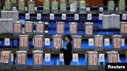 An election official waits for the start of ballot counting for Japan's lower house election at a counting centre in Tokyo, Japan, Oct. 22, 2017.