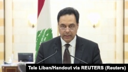 Lebanon, Beirut, Lebanon's Prime Minister Hassan Diab speaks at the government palace