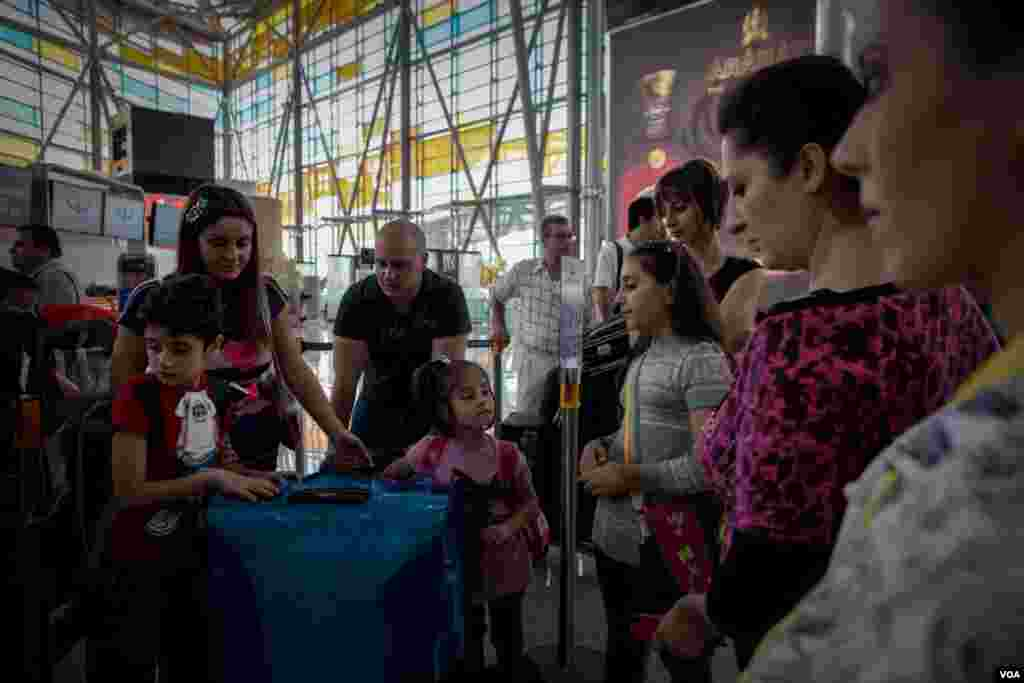 A Syrian-Armenian family waits at the departure gate at Zvartnots Airport in Yerevan, Armenia, December 2012. (VOA/D. Markosian)