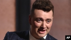 "FILE - Sam Smith accepts the award for record of the year for ""Stay With Me"" at the 57th annual Grammy Awards, Feb. 8, 2015."