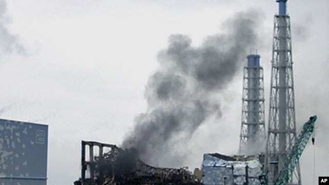 Smoke is seen coming from the area of the No. 3 reactor of the Fukushima Daiichi nuclear power plant in northeastern Japan, March 21, 2011