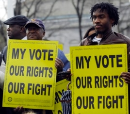 Voting rights activists gather in front of the U.S. Supreme Court in Washington Feb. 27, 2013.