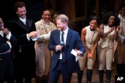 Prince Harry and Duchess Meghan Markle of Sussex pictured after the performance meeting cast and crew backstage at the Victoria Palace Theatre, London.