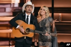 Hosts Brad Paisley, left, and Carrie Underwood speak at the 50th annual CMA Awards at the Bridgestone Arena in in Nashville, Tennessee, Nov. 2, 2016.