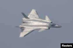 China unveils its J-20 stealth fighter during an air show in Zhuhai, Guangdong Province, China, Nov. 1, 2016.