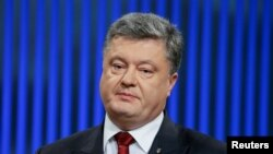 FILE - Ukrainian President Petro Poroshenko, pictured at a news conference in Kyiv in January 2016, says release of the IMF funds will help keep the hryvnia currency stable and aid his nation's economy.