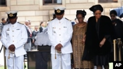 Nelson Mandela's widow Graca Machel leaves after viewing the casket at the Union Buildings in Pretoria, Dec. 11, 2013.