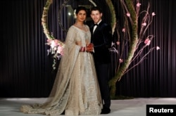 Bollywood actress Priyanka Chopra and her husband singer Nick Jonas arrive for a photo opportunity at their wedding reception in New Delhi, India December 4, 2018. REUTERS/Adnan Abidi