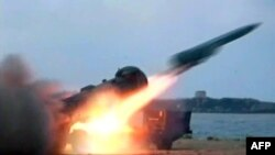 A handout picture released by the Syrian Arab News Agency on July 7, 2012, shows a missile being fired during a military excercise (AFP photo/ HO / SANA).