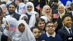 Children from Al-Rahmah school and other guests react after seeing President Barack Obama during his visit to the Islamic Society of Baltimore, Feb. 3, 2016.