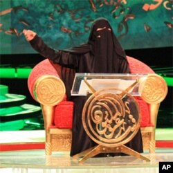 Hissa Hilal recites a poem during the final of the Million's Poet competition in Abu Dhabi