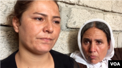 Alia looks on while her mother speaks to a VOA reporter pleading that the international community helps rescue the rest of the captive Yazidi men, women and children, including her other daughters, on the outskirts of Dohuk, northern Iraq, Aug. 2015. (Sharon Behn/VOA)