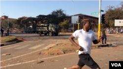 "Protesters are seen running from members of the army, in Harare, Zimbabwe, Aug. 7, 2018. On Tuesday, embassies of the European Union, the U.S., Canada and Switzerland in Harare issued a statement expressing concern over ""excessive use of force"" by Zimbabwe authorities against protesters of the opposition Movement for Democratic Change Alliance last week. (C. Mavhunga/VOA)"
