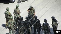 Sirijski vojnici na ulicama jednog od gradova u kojima već nedeljama traju anti-vladini protesti