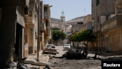 A view of destroyed buildings and cars after the street was controlled by forces loyal to Libyan commander Khalifa Haftar in Derna, Libya, June 13, 2018.