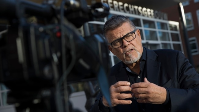 Emile Ratelband answers questions during an interview in Utrecht, Netherlands, Thursday, Nov. 8, 2018. (AP Photo/Peter Dejong)