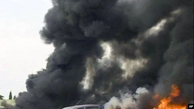 Image taken from APTN footage shows smoke bellowing after an explosion at the police headquarters, in Abuja, June 16, 2011