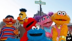 "FILE - Characters from ""Sesame Street Live"" appear on the street by Madison Square Garden to celebrate the 30th anniversary of the live touring stage shows based on the PBS television series in New York, Feb. 4, 2010. The nonprofit behind TV's ""Sesame Street"" is using the Muppets to entertain and instruct kids who've known nothing but war in the Mideast."