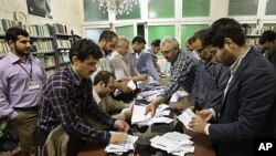 Electoral workers count ballots in a polling station, in Tehran, Iran, May 4, 2012.