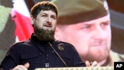FILE - Chechen regional leader Ramzan Kadyrov speaks at celebrations marking Defenders of the Fatherland Day in Chechnya's provincial capital Grozny, Russia, Feb, 20, 2016/