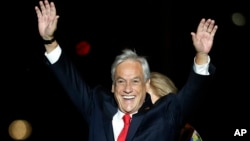 Chile's former President Sebastian Pinera waves to supporters as he celebrates winning the presidential election runoff in Santiago, Dec. 17, 2017.