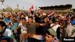 Followers of Iraqi Shi'ite cleric Moqtada al-Sadr shout slogans at Grand Festivities Square within the Green (International) Zone in Baghdad, Iraq, May 1, 2016.