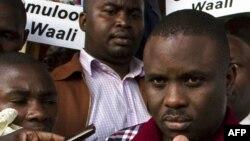 FILE - Kampala Lord Mayor Erias Lukwago (R) address the media outside the Buganda Magistrates court, Uganda.