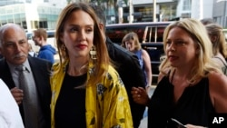 "Actress Jessica Alba, left, arrives on the opening night of the Los Angeles run of ""Hamilton: An American Musical"" at the Pantages Theatre on Aug. 16, 2017, in Los Angeles."